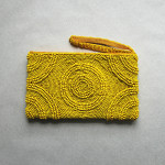 Yellow beaded clutch